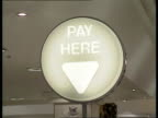 Mortgage repossessions EXT MS Shoppers along PULL OUT PAN RL `Halifax Building Society' INT CMS `Pay Here' illuminated sign PULL OUT check outs in...