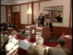 London Churchill Hotel TCMS Brochure for auction of repossessed houses on auctioneers stand next to gavel TILT UP people in auction room CMS...