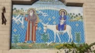 Mosaic of Jesus Mary and Joseph on side of Christian church in Cairo Egypt