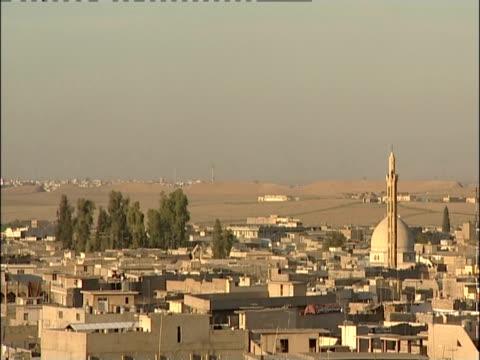 Mosque domes dominate the skyline of Mosul, Iraq.