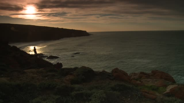 Mossel Bay is framed by a rocky coastline at sunset Available in HD.