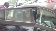 Most famous Indian actress Aishwarya Rai and sleeping child arriving at the Martinez Hotel