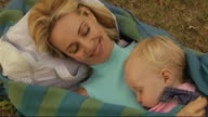 Mother and Baby asleep in Park