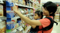 HD : Mother and Baby Shopping in supermarket