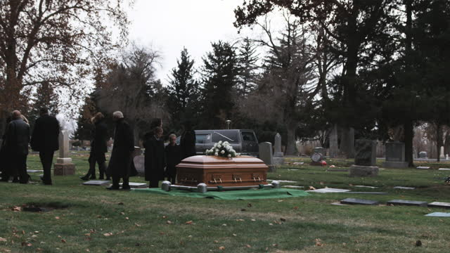 mother and children at a funeral