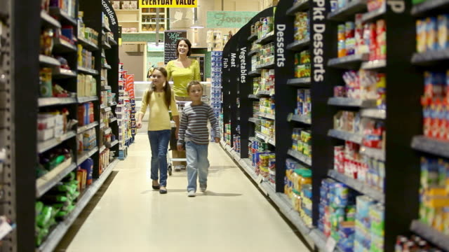 Mother and children in supermarket
