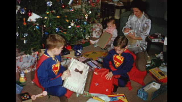 1956 HOME MOVIE Mother and children opening Christmas presents / Toronto, Canada