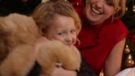 Mother and daughter at Christmas with Teddy Bear.