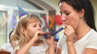 HD: Mother And Daughter Blowing Party Horn Blower