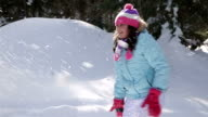 Mother and daughter cheerfully spend time in winter day