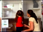 Mother and daughter choosing pet at pound