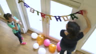 Mother and daughter decorating a room for a birthday party