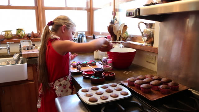 MS PAN Mother and daughter decorating cupcakes / Lamy, New Mexico, United States