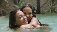 Mother and Daughter huging in pool of Holiday Home