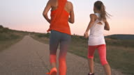 Mother and daughter jogging outdoors