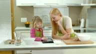 HD DOLLY: Mother And Daughter Looking Recipe On Tablet