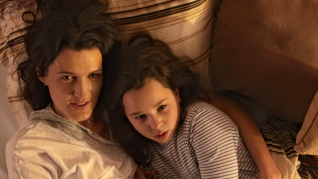HD: Mother And Daughter Lying In Embrace