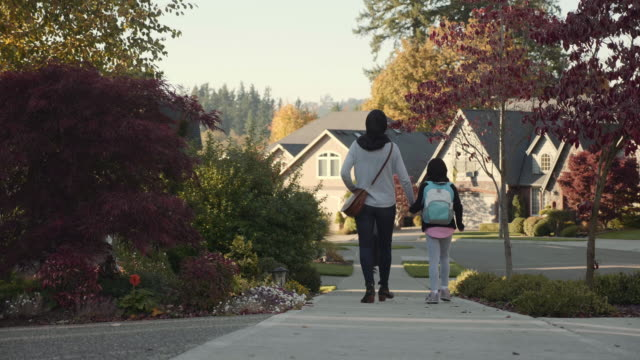 4K UHD: Mother and Daughter of Middle Eastern Descent Walk down a street