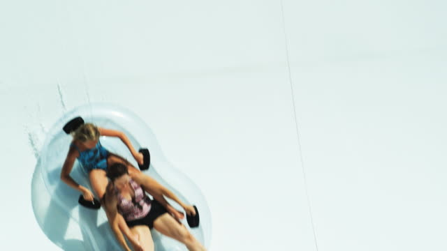 mother and daughter on a waterslide