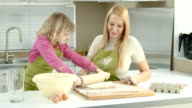 HD DOLLY: Mother And Daughter Rolling The Dough