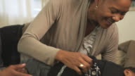 MS PAN Mother and grandmother tickling toddler  / Newark, New Jersey, USA