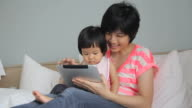 HD : Mother and her baby using Digital Tablet