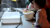 Mother and little girl making cookies