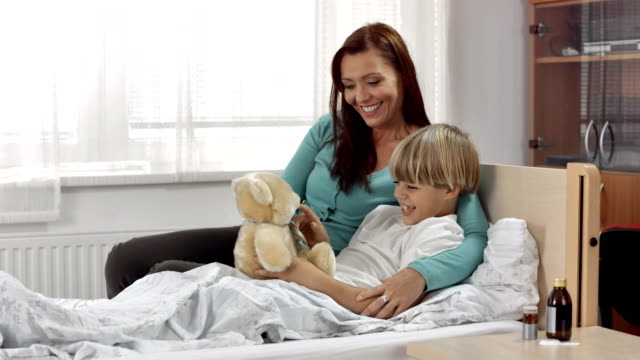 HD: Mother And Sick Son Playing With Teddy
