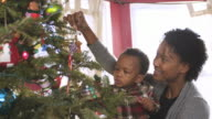 MS Mother and son decorating Xmas Tree / Newark, New Jersey, USA