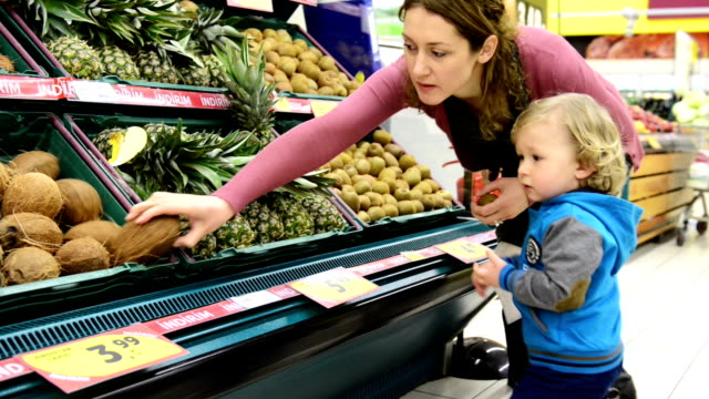 MONTAGE: Mother and son in supermarket
