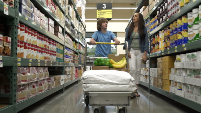 Mother and son shopping in a warehouse supermarket