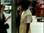 1969 MS TD Mother and son standing at pedestrian crossing on city street/ USA/ AUDIO