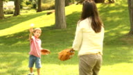 Mother and Son throw Baseball