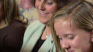 CU PAN Mother and two daughters (11-17) smiling / Heber City, Utah, USA