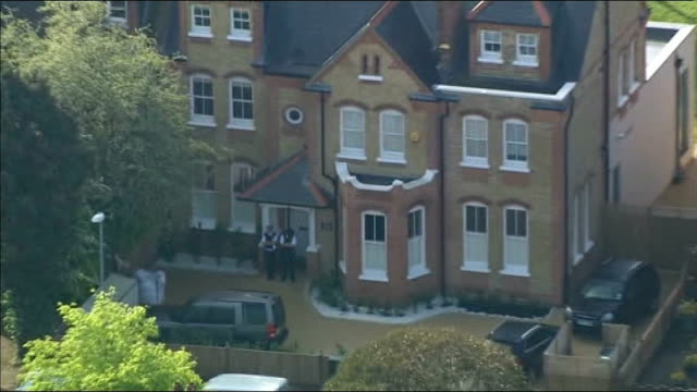 Mother arrested after three children found dead at house in New Malden ENGLAND London New Malden Police officers standing outside house where...
