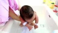 Mother bathing child