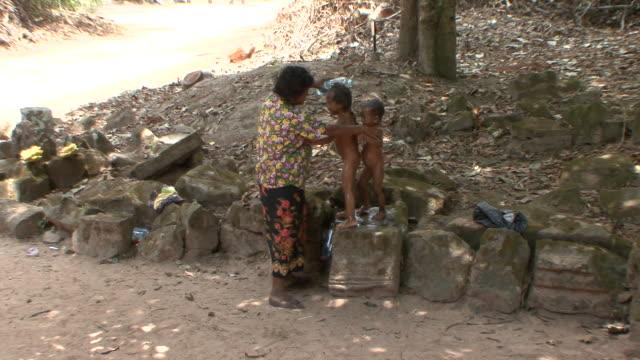 Ws Mother Bathing Children At Preah Khan Temple Siem Reap