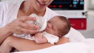CU TD Mother Bottle Feeding Newborn Baby in Hospital / Richmond, Virginia, USA