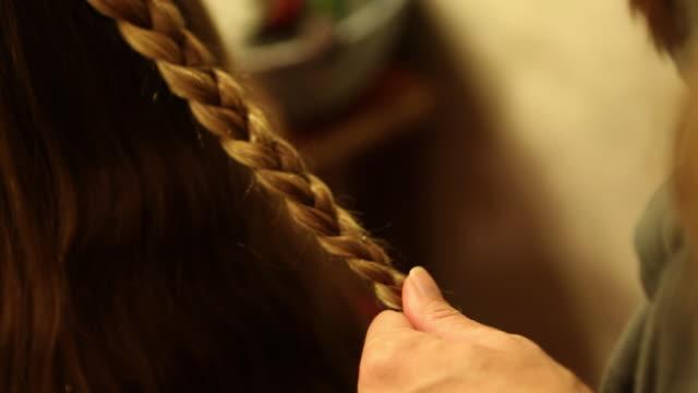 CU Mother braiding her daughter's hair / St. Simon's Island, Georgia, United States