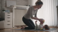 4K: Mother Exercise With Her Baby At Home.