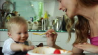 SLO MO CU Mother feeding baby boy (6-11 months) / London, United Kingdom