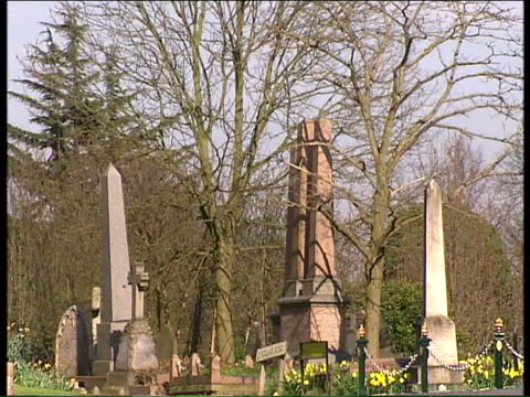 Mother fights to have son's body exhumed London St Pancras Cemetery EXT Gravestones at cemetery Sign on fence 'Islington Camden Cemetery Services'...