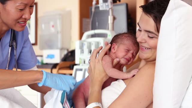 Mother Giving Birth to Newborn in Hospital