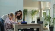 MS Mother helping daughter (10-11) in doing homework / Kleinmachnow, Brandenburg, Germany