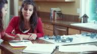 MS PAN Mother helping daughter in doing homework / Renton, Washington, USA