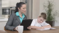 HD DOLLY: Mother Helping Her Son Doing Homework