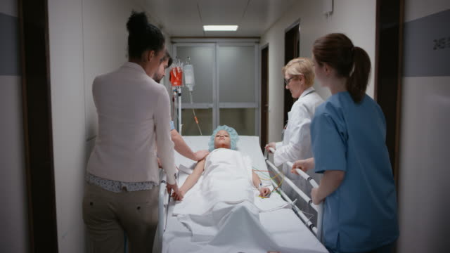 DS Mother holding her son's hand while he is being transported to the OR