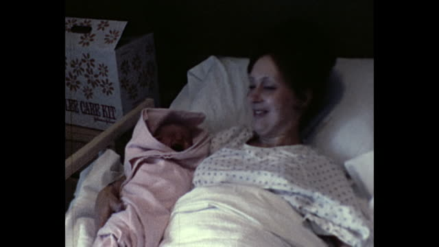 1974 Mother holding newborn baby