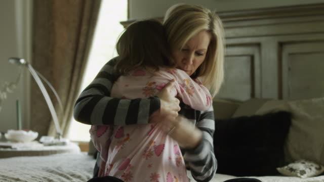 MS Mother hugging daughter(4-5) in bedroom / Cedar Hills, Utah, USA