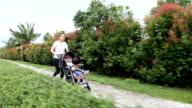 Mother jogging with baby boy in stroller.